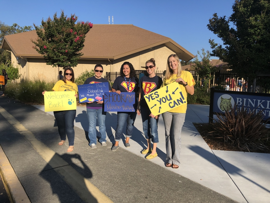 Binkley teachers welcome students with a smile and positive greetings.