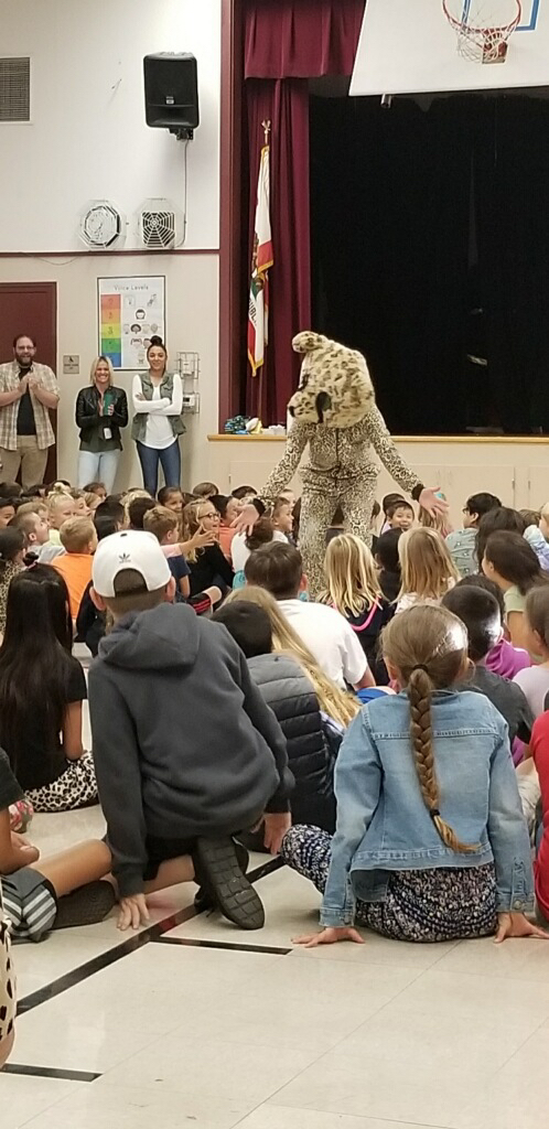 Cheetah mascot connecting with students