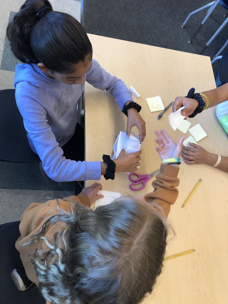 Fifth graders participating in a problem solving challenge to build the highest tower possible that could hold the weight of a penny...with only 5 index cards!