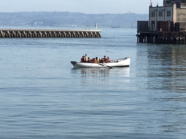 Students maneuvering their boat in the San Francisco Bay.