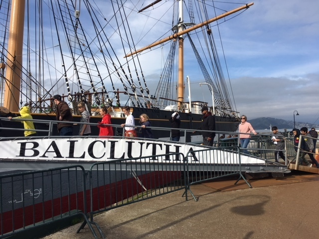 Students boarding the historic Balclutha ship.