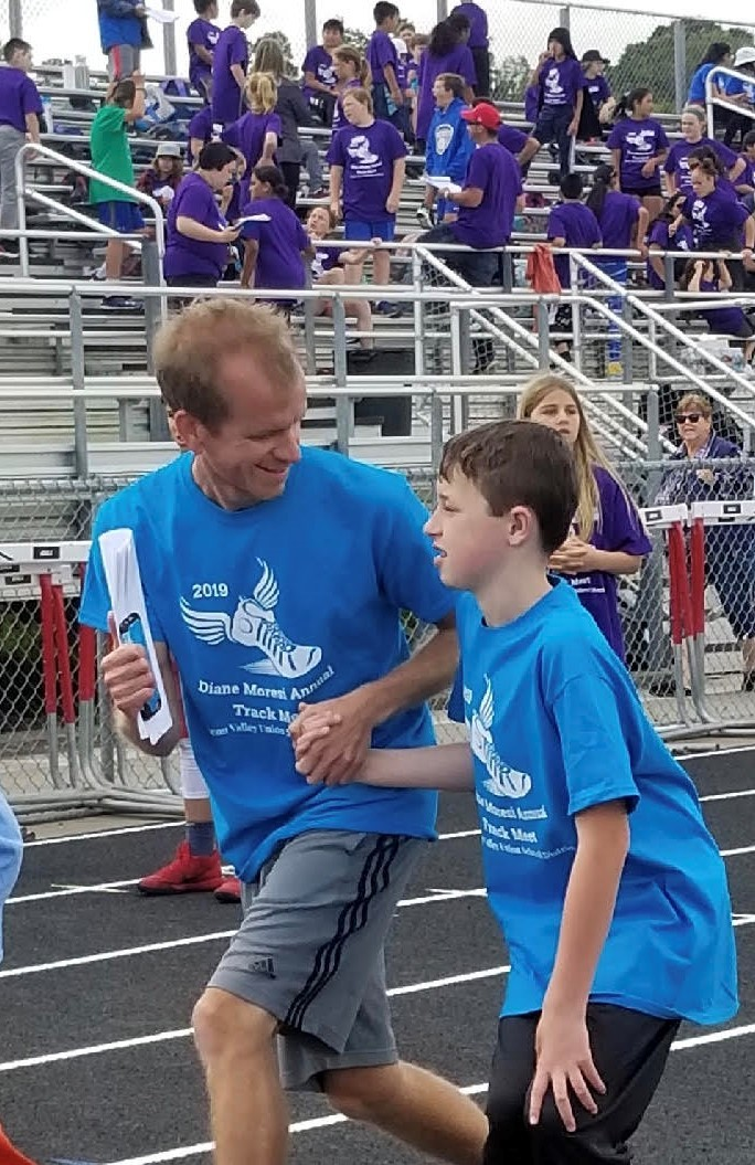 Student and coach at Special Olympics